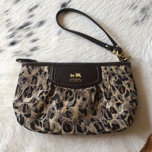 Gently used cheetah coach wristlet